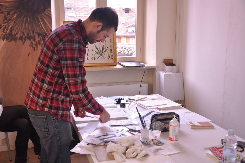 Daniele Fabiani at MUSES working on his collages and drawings.