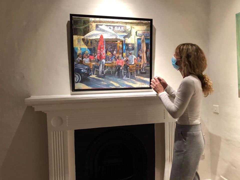 Catherine Cavallo hanging paintings 3