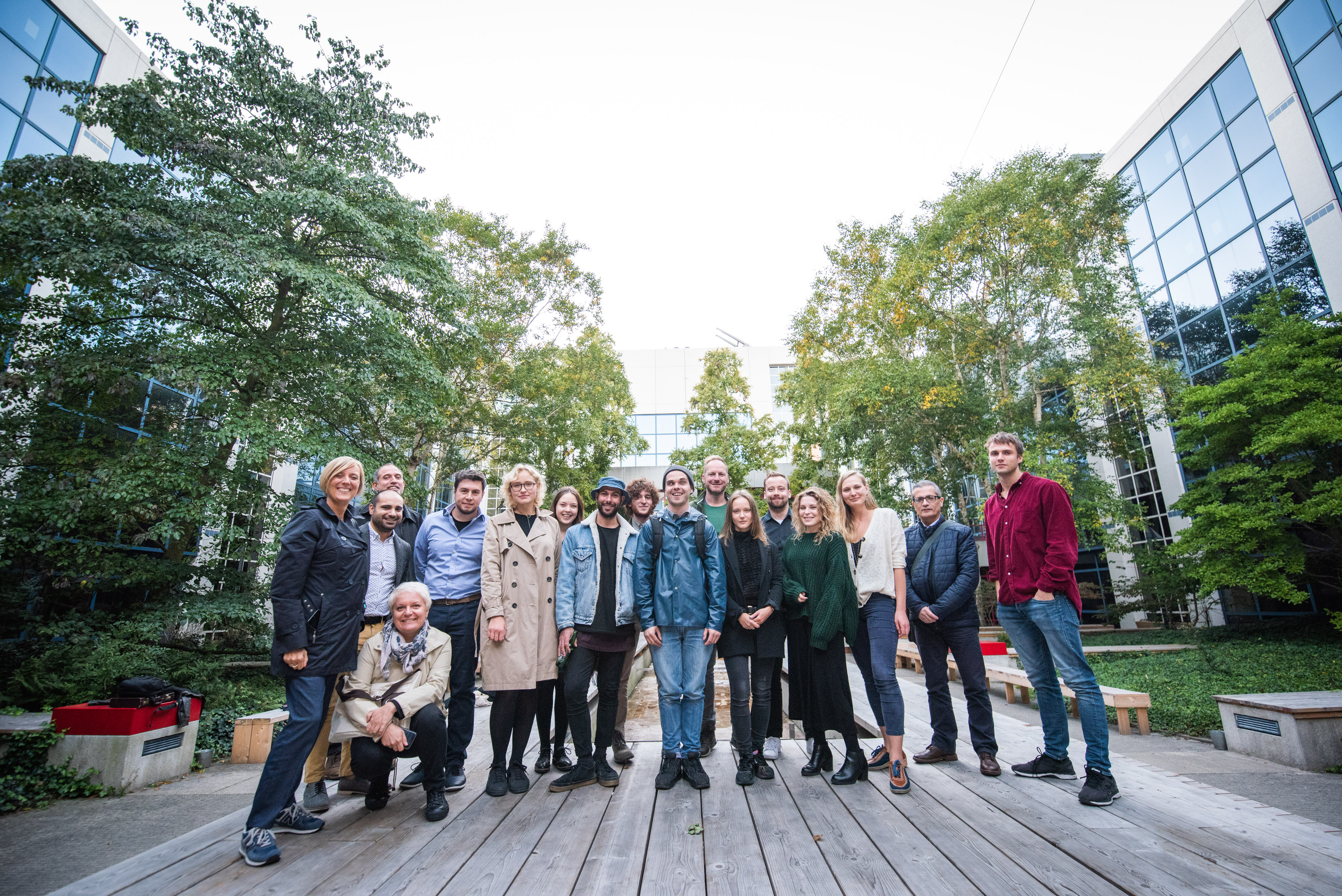 The whole group, including artists, committee members and artistic director
