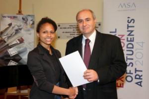 Dr Jose` Herrera presenting one of the certificates